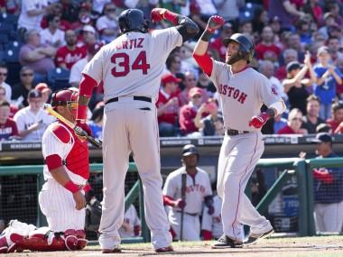 Dustin Pedroia celebrates one of his two solo home runs with David Ortiz
