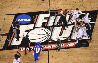 Duke storms the court after their four freshmen deliver a championship