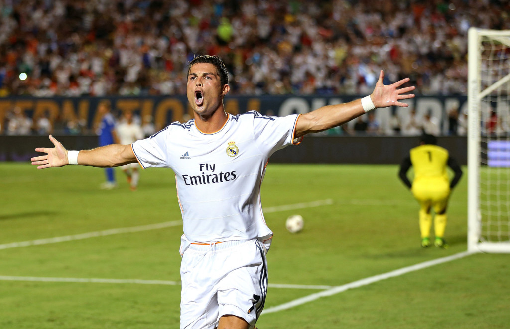 MIAMI GARDENS, FL - AUGUST 07:  Cristiano Ronaldo #7 of Real Madrid celebrates a goal during International Champions Cup  Championship match against Chelsea at Sun Life Stadium on August 7, 2013 in Miami Gardens, Florida.  (Photo by Mike Ehrmann/Getty Images)