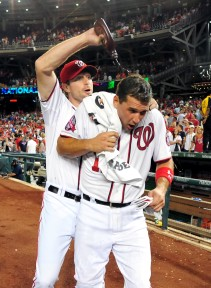 May 19, 2015; Washington, DC, USA; Washington Nationals first baseman Ryan Zimmerman (11) is doused with chocolate syrup by pitcher Max Scherzer (31) after beating the New York Yankees 8-6 at Nationals Park. Mandatory Credit: Evan Habeeb-USA TODAY Sports