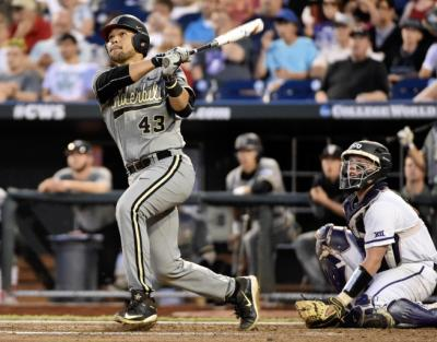 Vanderbilt's Zander Wiel (43) and TCU catcher Evan Skoug, right, follow Zander's solo home run ball in the seventh inning of an NCAA College World Series baseball game at TD Ameritrade Park in Omaha, Neb., Tuesday, June 16, 2015. (AP Photo/Mike Theiler)