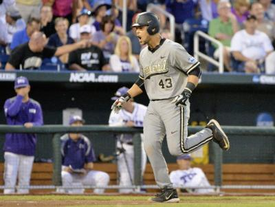 Vanderbilt's Zander Wiel (43) celebrates his solo home run against TCU in the seventh inning of an NCAA College World Series baseball game at TD Ameritrade Park in Omaha, Neb., Tuesday, June 16, 2015. (AP Photo/Ted Kirk)