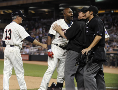 Jun 10, 2015; Minneapolis, MN, USA;  Minnesota Twins right fielder Torii Hunter (48) exchanges words with home plate umpire Mark Ripperger (far right) as first base umpire Jeff Kellogg (middle) gets between them due to Hunter being called out on strikes during the eighth inning against the Kansas City Royals at Target Field. Mandatory Credit: Marilyn Indahl-USA TODAY Sports