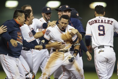 Correa gets mobbed by teammates after his walk-off single in extra innings last night