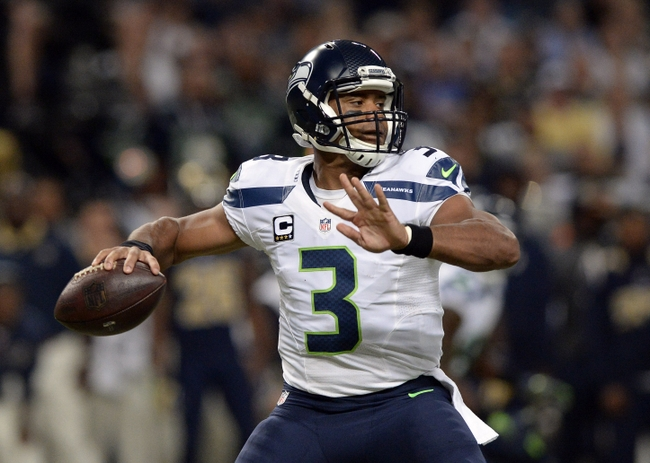 Sep 13, 2015; St. Louis, MO, USA; Seattle Seahawks quarterback Russell Wilson (3) passes against the St. Louis Rams during the first half at the Edward Jones Dome. Mandatory Credit: Jeff Curry-USA TODAY Sports