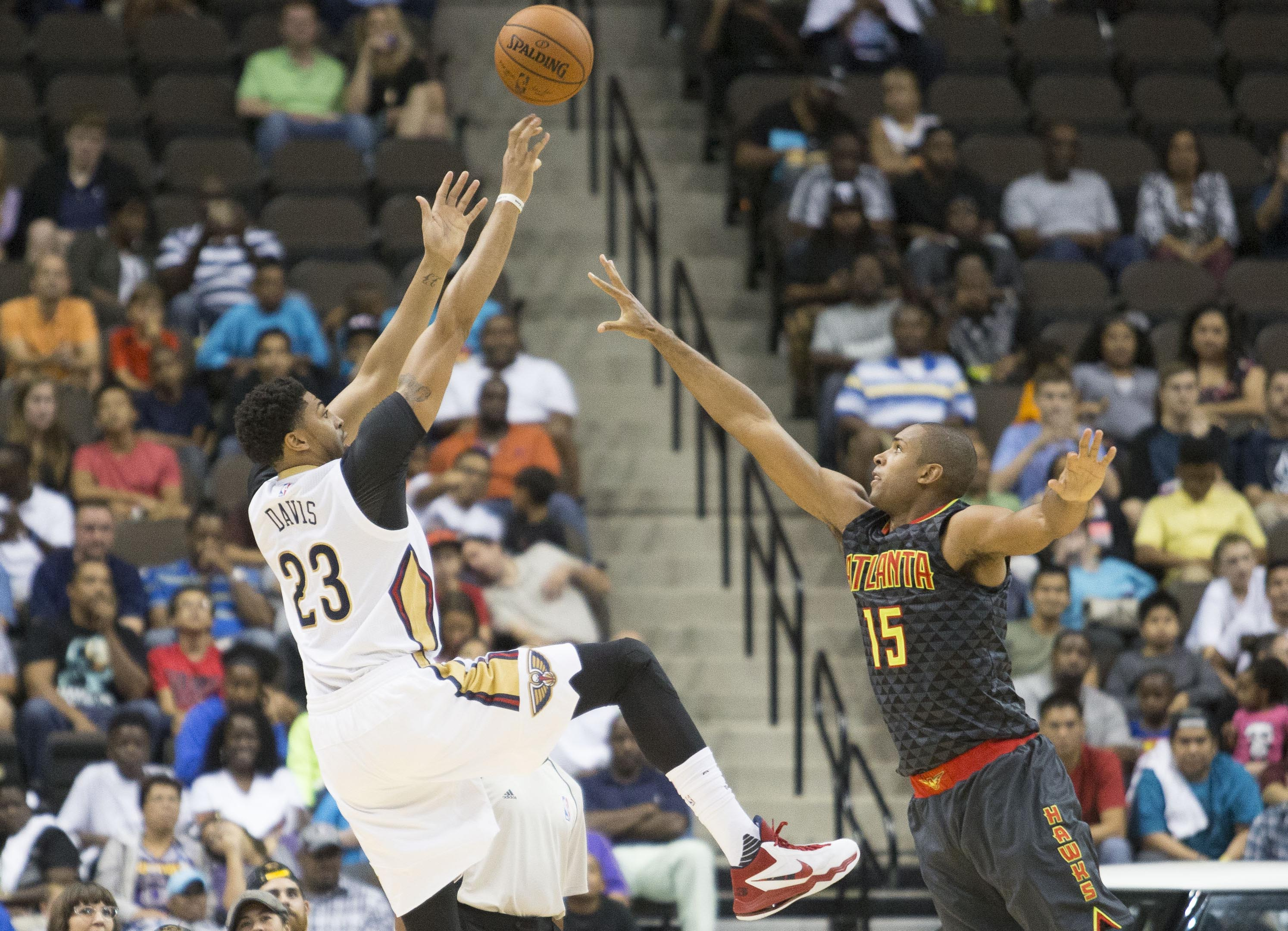 Oct 9, 2015; Jacksonville, FL, USA; New Orleans Pelicans forward Anthony Davis (23) shoots the ball against Atlanta Hawks forward Al Horford (15) during the second quarter at Veterans Memorial Arena. Mandatory Credit: Logan Bowles-USA TODAY Sports