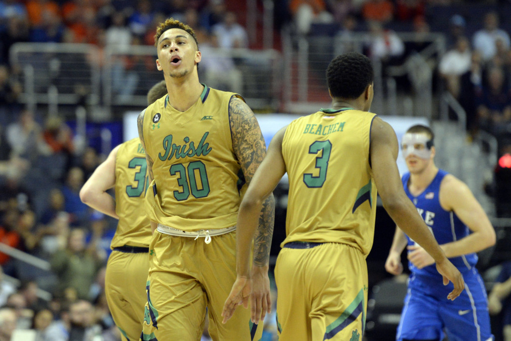Mar 10, 2016; Washington, DC, USA; Notre Dame Fighting Irish forward Zach Auguste (30) celebrates after scoring in the second half against the Duke Blue Devils during day three of the ACC conference tournament at Verizon Center. Notre Dame Fighting Irish defeated Duke Blue Devils 84-79 in overtime Mandatory Credit: Tommy Gilligan-USA TODAY Sports