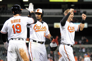 Apr 20, 2016; Baltimore, MD, USA; Baltimore Orioles catcher Caleb Joseph (36) celebrates with outfielder Adam Jones (10) and first baseman Chris Davis (19) after scoring the game winning run to defeat the Toronto Blue Jays 4-3 at Oriole Park at Camden Yards. Mandatory Credit: Evan Habeeb-USA TODAY Sports