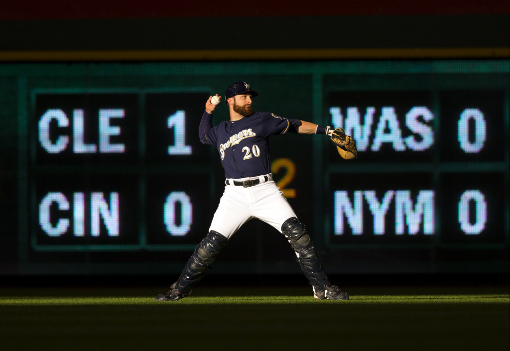 May 18, 2016; Milwaukee, WI, USA; Milwaukee Brewers catcher Jonathan Lucroy (20) throws in the outfield prior to the game against the Chicago Cubs at Miller Park. Mandatory Credit: Jeff Hanisch-USA TODAY Sports