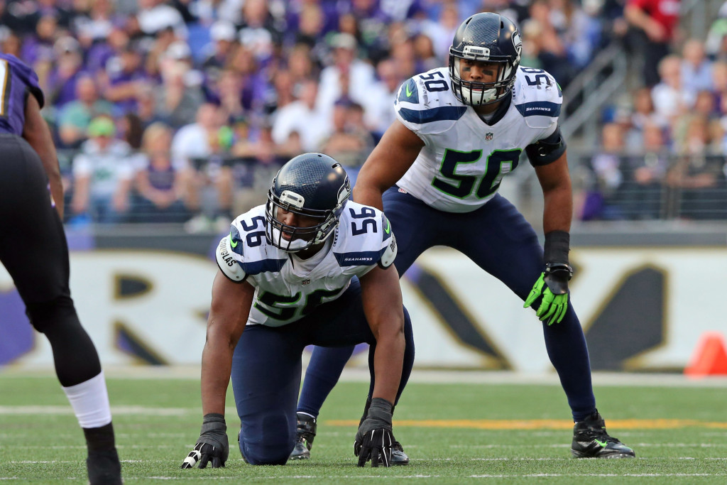 Dec 13, 2015; Baltimore, MD, USA; Seattle Seahawks defensive end Cliff Avril (56) and linebacker KJ Wright (50) await the snap against the Baltimore Ravens at M&T Bank Stadium. Mandatory Credit: Mitch Stringer-USA TODAY Sports